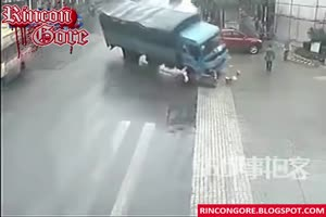Motorcyclist run over and crushed by truck
